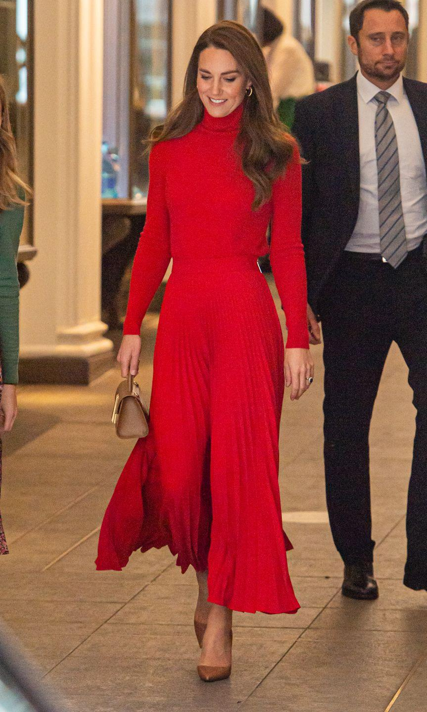"""<p>Kate Middleton sported an elegant, monochrome red outfit to attend The Forward Trust's """"Taking Action on Addiction"""" campaign, which aims to help individuals overcome addiction. She accessorized a sleek turtleneck and pleated skirt with a tan <a href=""""https://go.redirectingat.com?id=74968X1596630&url=https%3A%2F%2Fwww.demellierlondon.com%2Fthe-nano-montreal.html&sref=https%3A%2F%2Fwww.townandcountrymag.com%2Fstyle%2Ffashion-trends%2Fnews%2Fg1633%2Fkate-middleton-fashion%2F"""" rel=""""nofollow noopener"""" target=""""_blank"""" data-ylk=""""slk:DeMellier London"""" class=""""link rapid-noclick-resp"""">DeMellier London </a>purse and pointed stilettos.</p>"""