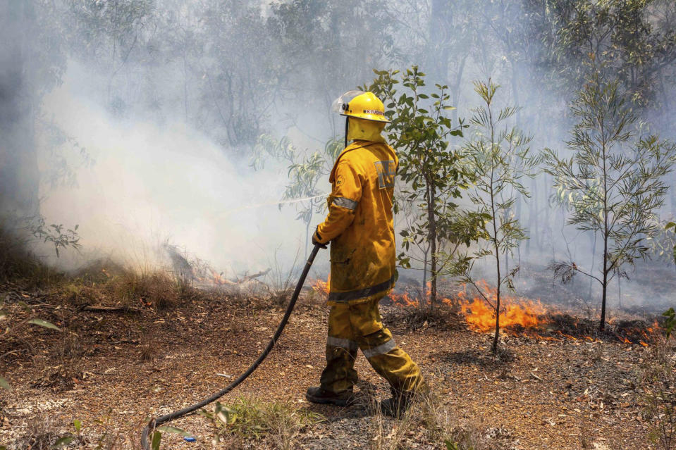 Thousands of Queenslanders were forced from their homes as firefighters battled up to 140 wildfires. Image: AAP