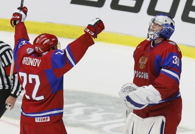 Russia's Andrei Mironov (L) and Russia's goalie Andrei Vasilevski celebrate after Russia defeated Canada to win the bronze medal in their IIHF World Junior Championship ice hockey game in Malmo, Sweden, January 5, 2014. REUTERS/Alexander Demianchuk (SWEDEN - Tags: SPORT ICE HOCKEY)