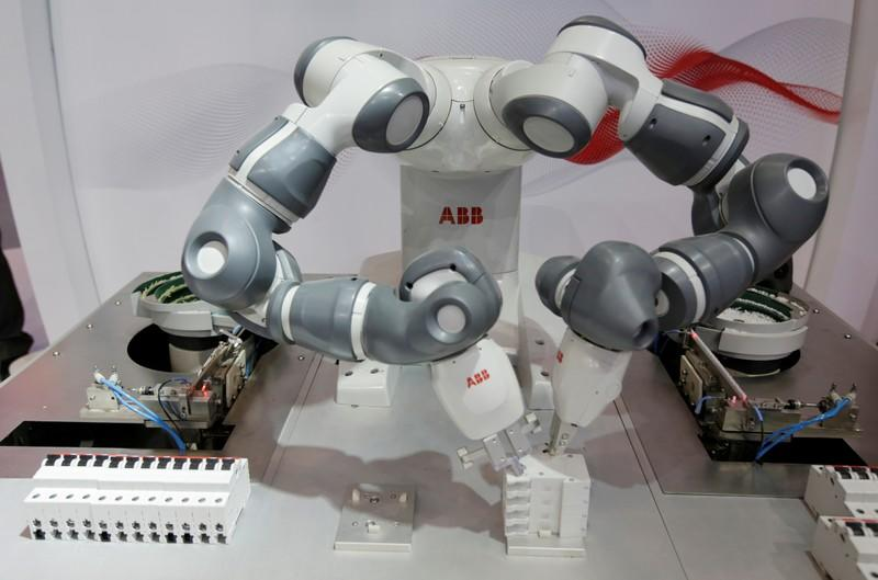 FILE PHOTO: An ABB's YuMi with double robotic arms performs at China International Fair for Trade in Services in Beijing