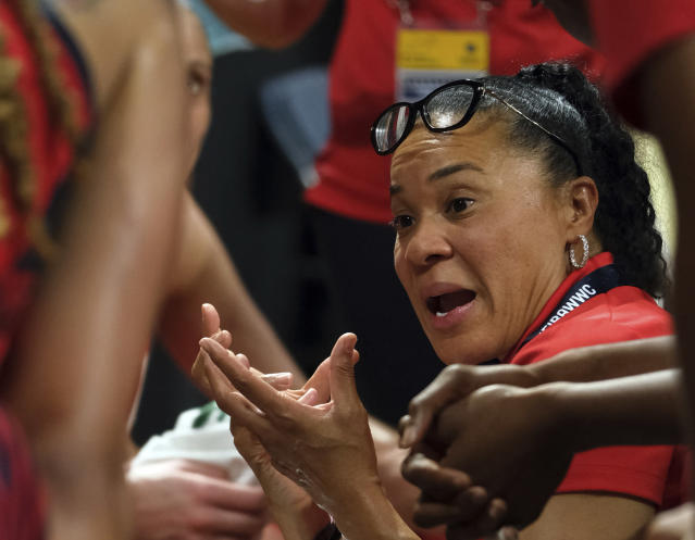 FILE - In this Sunday Sept. 30, 2018, file photo, United States coach Dawn Staley gives instructions to her players during the Women's basketball World Cup final match against Australia Tenerife, Spain. Staley began fall practice Thursday, Oct. 4, 2018, hoping her experience leading the worlds best players to a FIBA World Cup crown can help mold the young Gamecocks into a championship group. (AP Photo/Andres Gutierrez, FIle)
