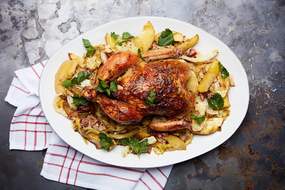 """Roast a lemon-and-garlic-basted chicken over a mess of potatoes, cabbage, and bacon for a one-pan dish that's rich with satisfying flavor. <a href=""""https://www.epicurious.com/recipes/food/views/roast-chicken-with-smothered-cabbage-bacon-and-potatoes?mbid=synd_yahoo_rss"""" rel=""""nofollow noopener"""" target=""""_blank"""" data-ylk=""""slk:See recipe."""" class=""""link rapid-noclick-resp"""">See recipe.</a>"""