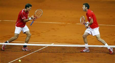 Canada's Vasek Pospisil (L) and Daniel Nestor celebrate a point against Serbia's Nenad Zimonjic and Ilija Bozoljac during their Davis Cup semi-final tennis doubles match in Belgrade September 14, 2013. REUTERS/Marko Djurica