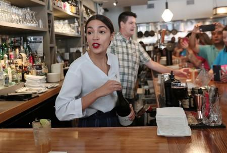 Rep. Alexandria Ocasio-Cortez (D-NY) serves drinks in support of One Fair Wage at The Queensboro restaurant in the Queens borough of New York