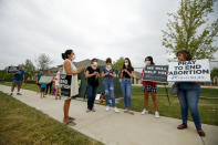 Anti-abortion demonstrators pray and protest outside of a Whole Women's Health of North Texas, Friday, Oct. 1, 2021, in McKinney, Texas. A federal judge did not say when he would rule following a nearly three-hour hearing in Austin during which abortion providers sought to block the nation's most restrictive abortion law, which has banned most abortions in Texas since early September. (AP Photo/Brandon Wade)