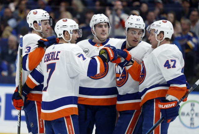 New York Islanders' Jordan Eberle (7) is congratulated by teammate Leo Komarov (47) after scoring during the third period of an NHL hockey game against the St. Louis Blues, Saturday, Jan. 5, 2019, in St. Louis. (AP Photo/Jeff Roberson)