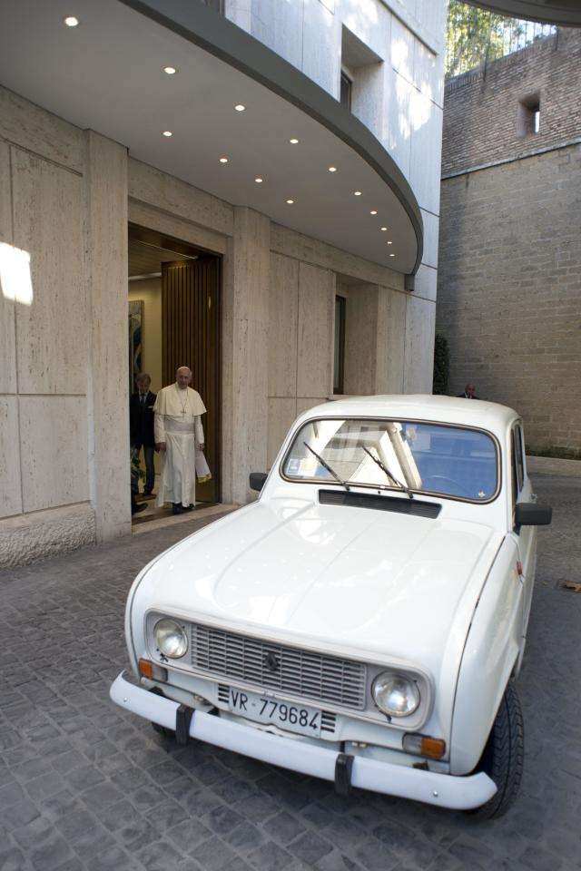 Pope Francis is presented with a Renault 4 car during a private audience with Don Renzo Zocca at the Vatican in this picture taken September 7, 2013 and released by Osservatore Romano September 10, 2013. REUTERS/Osservatore Romano (VATICAN - Tags: RELIGION TRANSPORT)   ATTENTION EDITORS - THIS IMAGE WAS PROVIDED BY A THIRD PARTY. FOR EDITORIAL USE ONLY. NOT FOR SALE FOR MARKETING OR ADVERTISING CAMPAIGNS. NO SALES. NO ARCHIVES. THIS PICTURE IS DISTRIBUTED EXACTLY AS RECEIVED BY REUTERS, AS A SERVICE TO CLIENTS