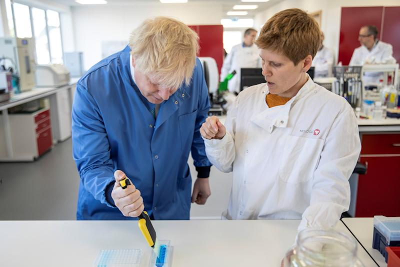 Britain's Prime Minister Boris Johnson visits the Mologic Laboratory in the Bedford Technology Park near Bedford, Britain March 6, 2020. Jack Hill/Pool via REUTERS