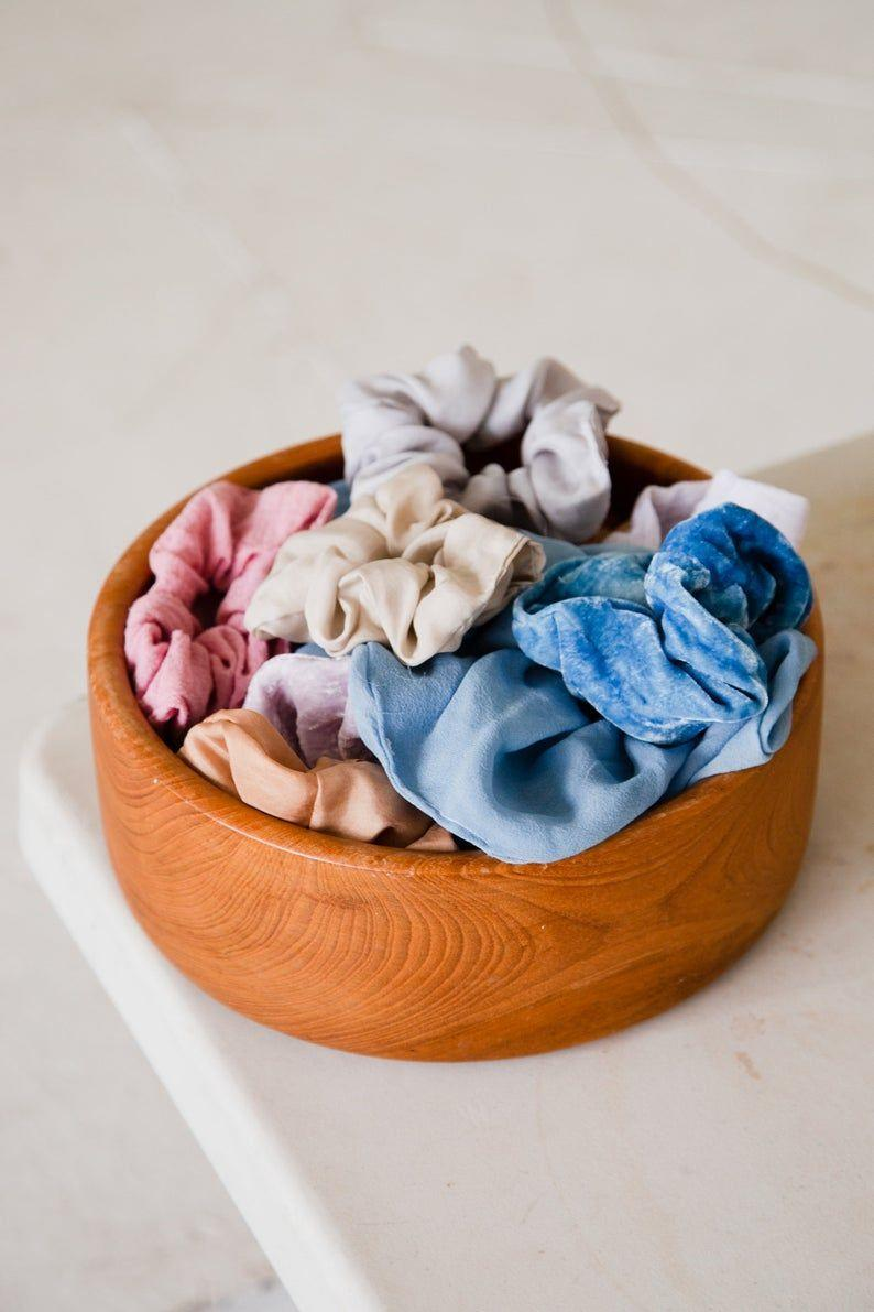 """<p><strong>RosemarineTextiles</strong></p><p>etsy.com</p><p><strong>$24.00</strong></p><p><a href=""""https://go.redirectingat.com?id=74968X1596630&url=https%3A%2F%2Fwww.etsy.com%2Flisting%2F715057094%2Frust-silk-scrunchie-dyed-with-acacia&sref=https%3A%2F%2Fwww.thepioneerwoman.com%2Fholidays-celebrations%2Fgifts%2Fg32161232%2Fbest-friend-gifts%2F"""" rel=""""nofollow noopener"""" target=""""_blank"""" data-ylk=""""slk:Shop Now"""" class=""""link rapid-noclick-resp"""">Shop Now</a></p><p>Keep them looking chic with these fun scrunchies. They're naturally dyed, so they're environmentally friendly too!</p>"""