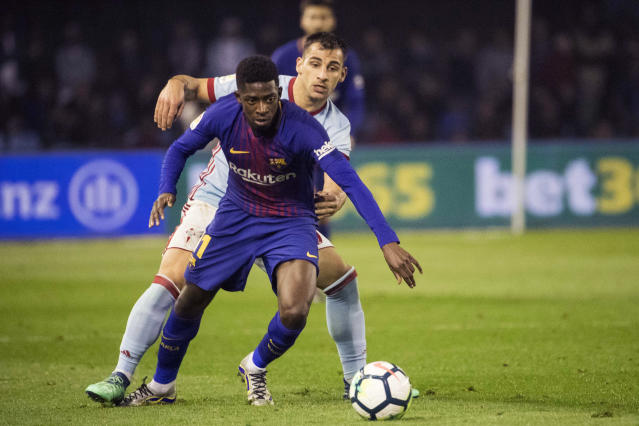 Barcelona's Ousmane Dembele, foreground, challenges for the ball with RC Celta's Jonny Otto during a Spanish La Liga soccer match between RC Celta and Barcelona at the Balaidos stadium in Vigo, Spain, Tuesday, April 17, 2018. (AP Photo/Lalo R. Villar)