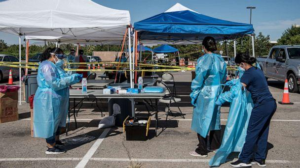 PHOTO: Nurses prepare themselves for coronavirus testing at a newly opened mega drive-thru testing site at El Paso Community College Valle Verde campus on July 21, 2020 in El Paso, Texas. (Cengiz Yar/Getty Images)