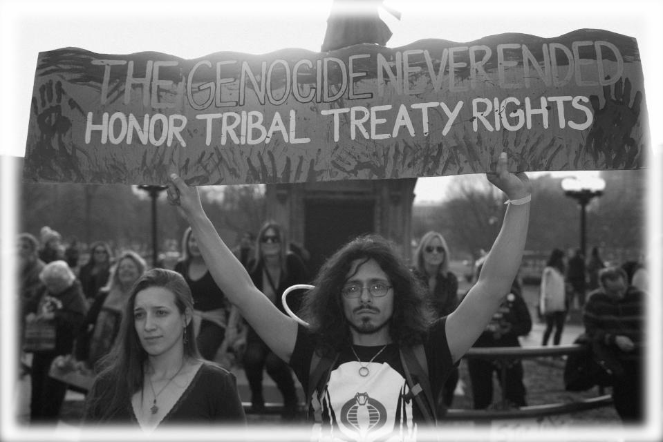 Native Americans and indigenous rights activists gather hold up a sign in protest during a Native Nations March in Denver, Colorado in 2017. (Photo: Jason Connolly/AFP/Getty Images; digitally enhanced by Yahoo News)