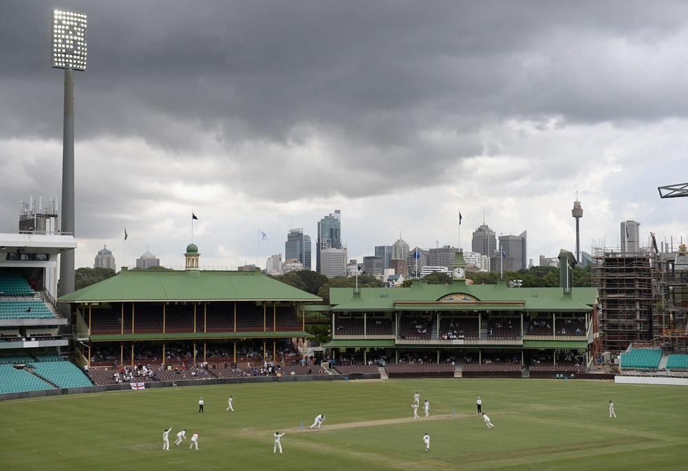 Dark clouds hover over the city as Joe Root and Jonathan Bairstow of England bat against the CA Invitational XI during day three of the tour match between CA Invitational XI and England at the Sydney Cricket Ground on November 15, 2013 in Sydney, Australia.  (Photo by Gareth Copley/Getty Images)