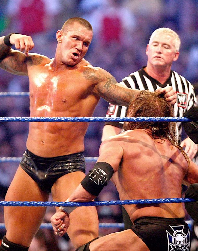 """During the main event, tattooed trash-talker Randy Orton pummeled Triple H with a barrage of right hands. Bob Levey/<a href=""""http://www.wireimage.com"""" target=""""new"""">WireImage.com</a> - April 5, 2009"""