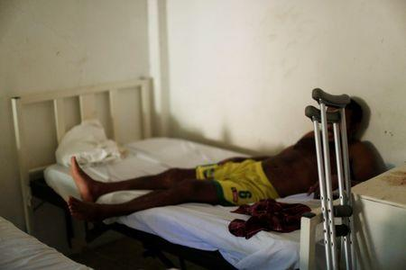 File photo: A man from Honduras who does not want to be identified, recovers from a bullet wound in his leg at the Jesus Buen Pastor shelter in Tapachula, Chiapas, Mexico