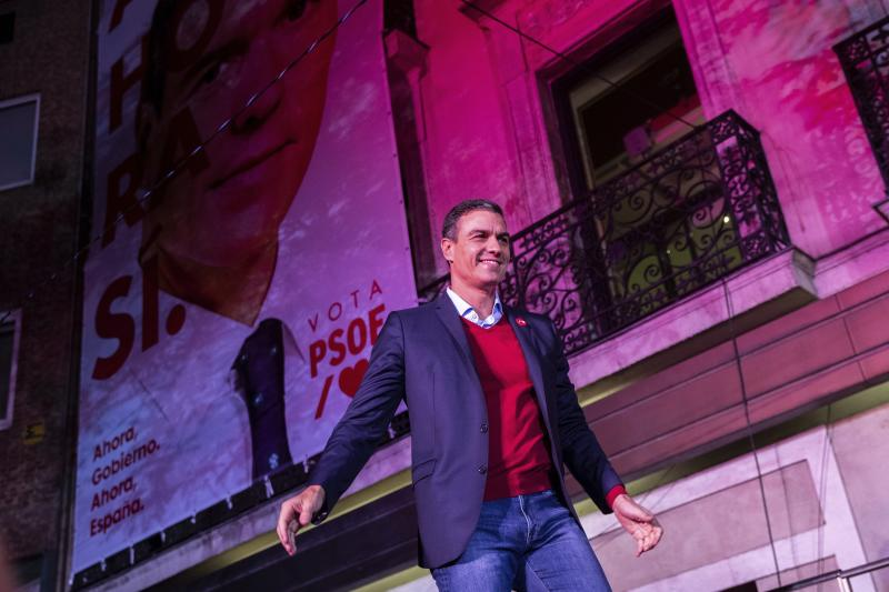 Spain's Prime Minister and Socialist Party leader Pedro Sanchez meets supporters, not pictured, outside the party headquarters following the general election in Madrid, Spain, Sunday, Nov.10, 2019. Spain's Interior Ministry says that early results show Socialists winning Spain's national election, but without a clear end to the country's political deadlock. (AP Photo/Bernat Armangue)
