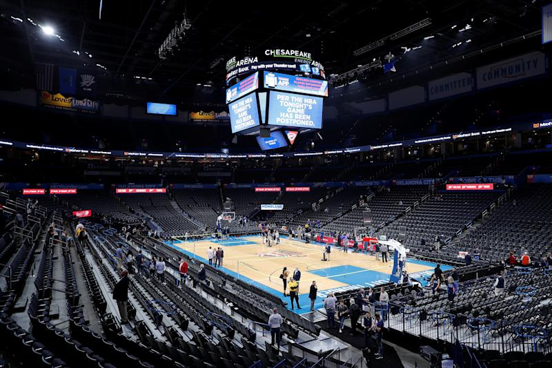 Mar 11, 2020; Oklahoma City, Oklahoma, USA; Fan leave after an announcement that the Oklahoma City Thunder vs. Utah Jazz game is canceled just before the tip off at Chesapeake Energy Arena. Mandatory Credit: Alonzo Adams-USA TODAY Sports TPX IMAGES OF THE DAY