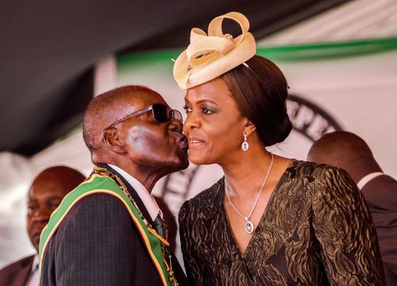 President Robert Mugabe kisses his wife and first lady Grace Mugabe