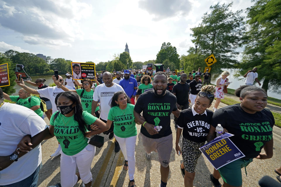 Mona Hardin, center, mother of Ronald Greene, participates in a march from the state Capitol to the governor's mansion in Baton Rouge, La., Thursday, May 27, 2021, protesting the death of Greene, who died in the custody of Louisiana State Police in 2019. (AP Photo/Gerald Herbert)