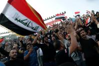 """Followers of a political movement called """"Al-Fateh Alliance"""" chant during a rally before the parliamentary elections in Baghdad, Iraq, Tuesday, Oct. 5, 2021. Iraq on Sunday, Oct. 10, holds its fifth election since the 2003 U.S.-led invasion that toppled Iraqi dictator Saddam Hussein, with most Iraqis longing for real change. (AP Photo/Khalid Mohammed)"""