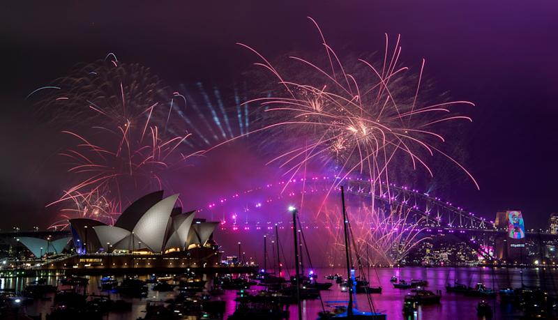 Fireworks explode over the Sydney Harbour during New Year's Eve celebrations in Sydney, Monday, Dec. 31, 2018. (Brendan Esposito/AAP via AP)