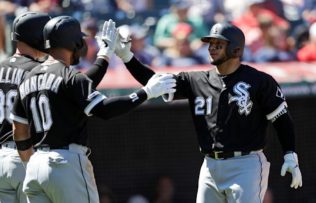 Chicago White Sox's Welington Castillo, right, is congratulated by teammates after hitting a two-run home run in the second inning in a baseball game against the Cleveland Indians, Thursday, Sept. 5, 2019, in Cleveland. (AP Photo/Tony Dejak)