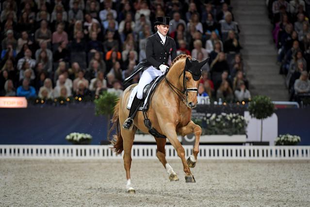Equestrian - Sweden International Horse Show - FEI Grand Prix Freestyle to Music event - Friends Arena, Stockholm, Sweden - December 3, 2017 - Cathrine Dufour of Denmark rides her horse Atterupgaards Cassidy. TT News Agency/Jessica Gow via REUTERS ATTENTION EDITORS - THIS IMAGE WAS PROVIDED BY A THIRD PARTY. SWEDEN OUT. NO COMMERCIAL OR EDITORIAL SALES IN SWEDEN