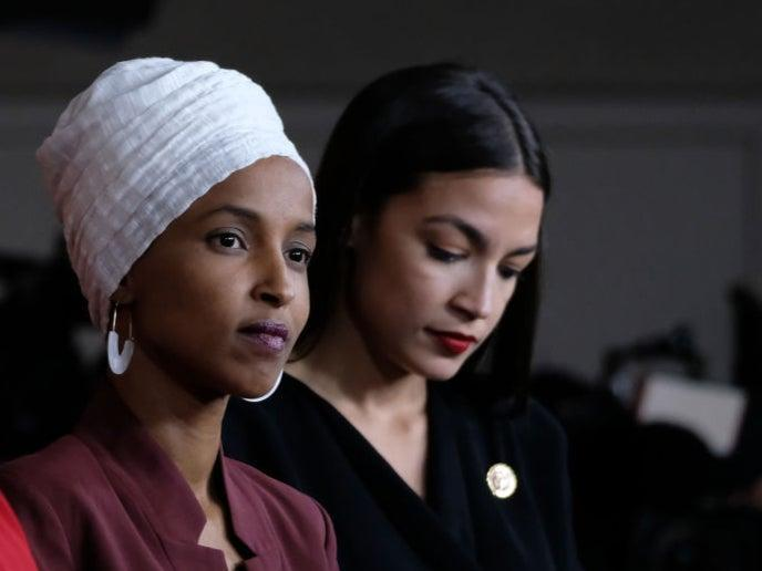 <p>Ilhan Omar and Alexandria Ocasio-Cortez </p> (Getty Images)