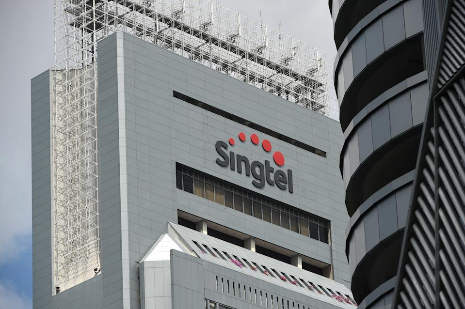 Singtel logo is seen on its headquarter building in Singapore on May 12, 2016. Singapore Telecom (Singtel) on May 12 reported a full-year net profit rise, driven by increased mobile data usage as more customers browse the Internet on handheld devices. / AFP / ROSLAN RAHMAN        (Photo credit should read ROSLAN RAHMAN/AFP via Getty Images)