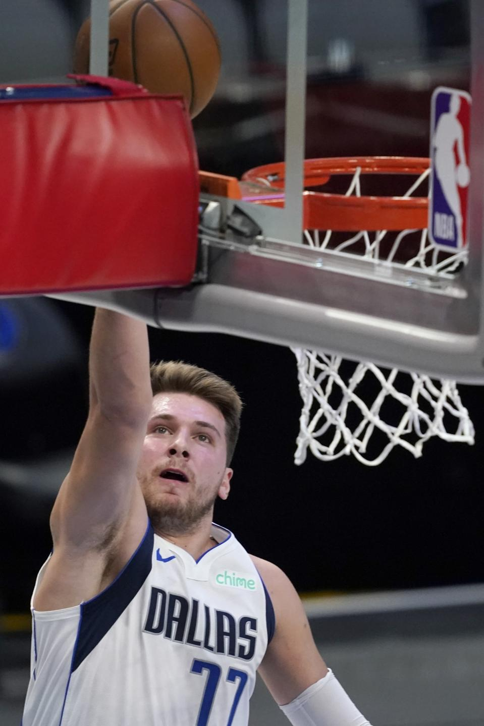 Dallas Mavericks guard Luka Doncic goes up for a shot in the first half of an NBA preseason basketball game against the Minnesota Timberwolves in Dallas, Thursday, Dec. 17, 2020. (AP Photo/Tony Gutierrez)