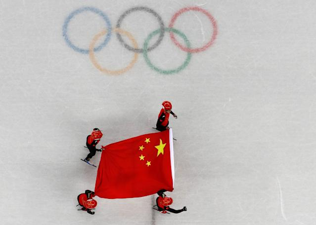 Short Track Speed Skating Events - Pyeongchang 2018 Winter Olympics - Men's 5000m Relay Final - Gangneung Ice Arena - Gangneung, South Korea - February 22, 2018 - Silver medallists Wu Dajing, Han Tianyu, Xu Hongzhi of China and Chen Dequan of China carry their national flag. REUTERS/Lucy Nicholson TPX IMAGES OF THE DAY