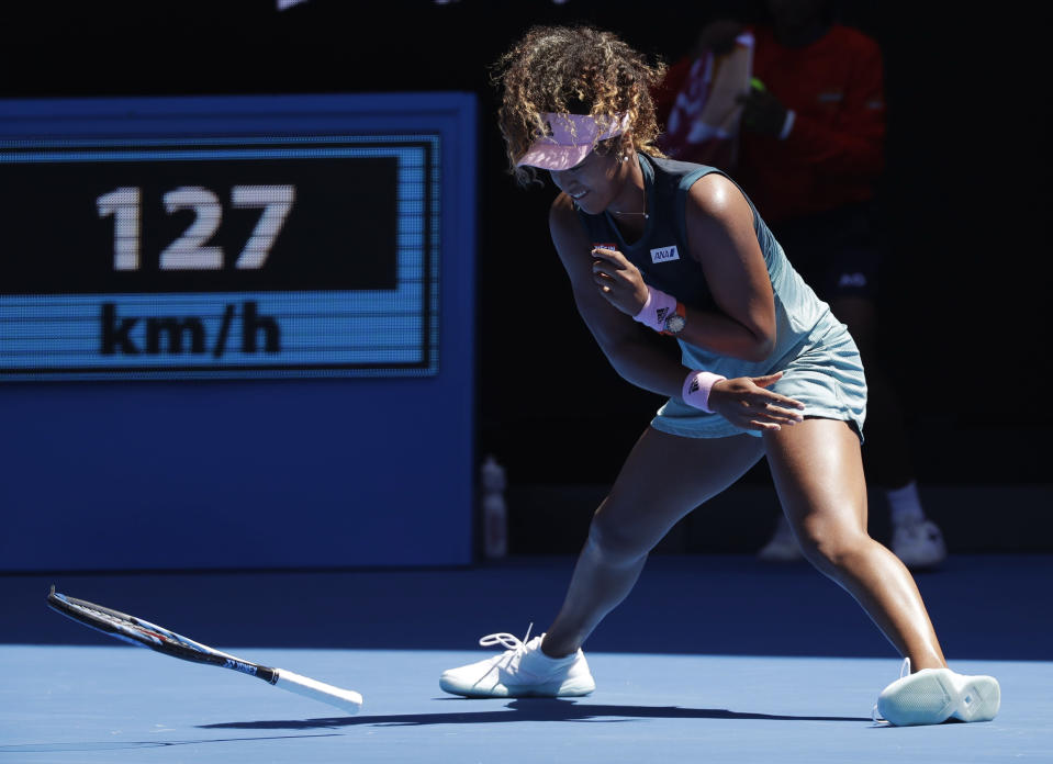 Japan's Naomi Osaka throws her racket in frustration during her third round match against Taiwan's Hsieh Su-Wei at the Australian Open tennis championships in Melbourne, Australia, Saturday, Jan. 19, 2019. (AP Photo/Kin Cheung)
