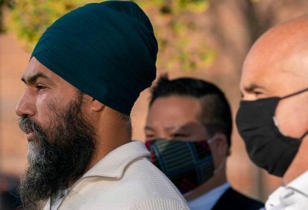 NDP Leader Jagmeet Singh told reporters in the Ontario riding of Toronto Centre today that the Liberals have failed on the climate file despite two prominent environmentalists' backing the Liberal climate plan over the NDP's plan.  (Jonathan Hayward/The Canadian Press - image credit)