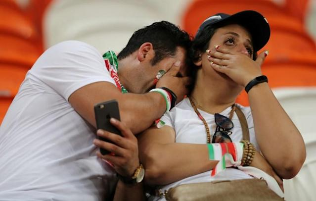 <p>Iran fans look dejected after the match. REUTERS/Ivan Alvarado </p>