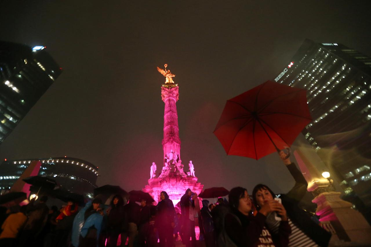 The Angel de la Independencia monument is lit up in pink during a demonstration in support of gay marriage, sexual and gender diversity in Mexico City, Mexico, September 23, 2016. REUTERS/Edgard Garrido