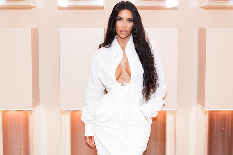 Kim Kardashian received a backlash from fans after naming her shapewear brand Kimono. [Photo: Getty]