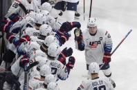 United States' Cole Caufield (13) is congratulated for his goal against Finland during the second period of a game in preparation for the IIHF World Junior Hockey Championships, in Edmonton, Alberta, Tuesday, Dec. 22, 2020. (Jason Franson/The Canadian Press via AP)