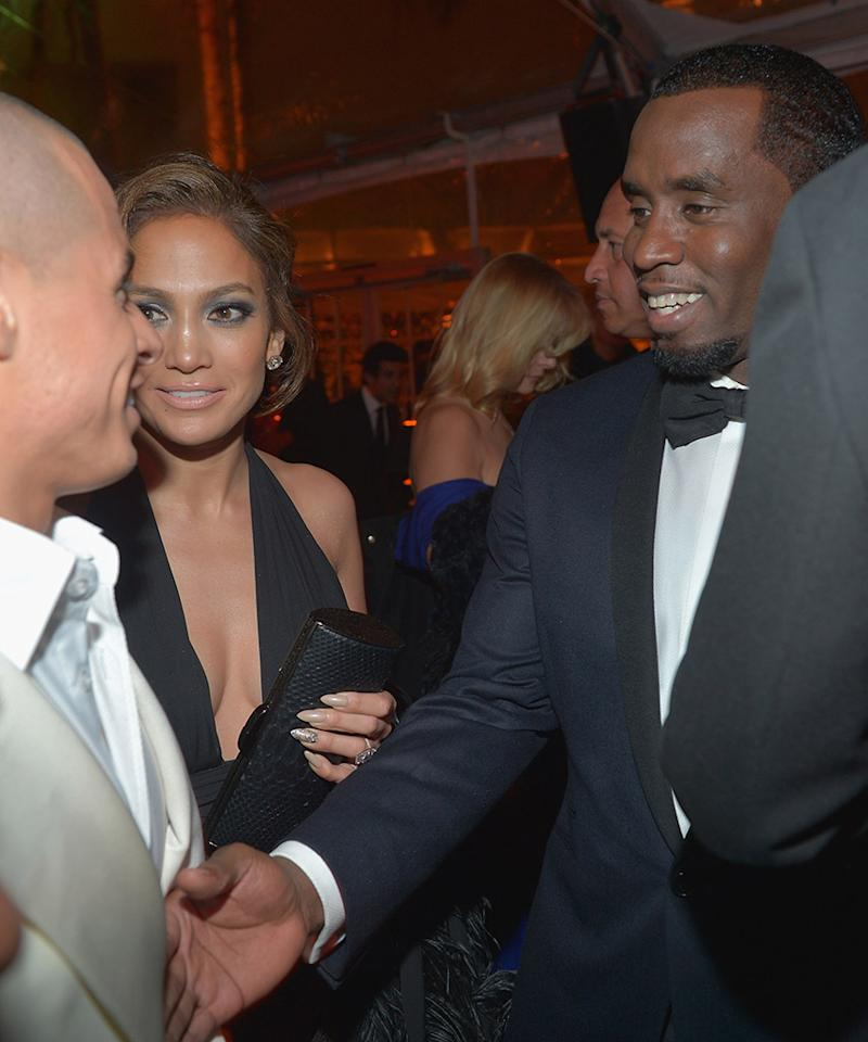 "<p>Awkward! J.Lo's then-boyfriend, Smart, left, shook hands with her ex-boyfriend, Diddy, at the 2013 affair. ""This guy? Really?"" Combs seems to be thinking. Expect Alex Rodriguez to be on Lopez's arm at this year Globes. (Photo: Charley Gallay/Getty Images for Chopard) </p>"