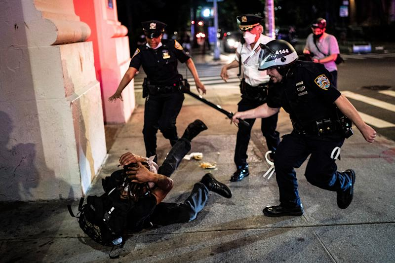 Officers in New York City chase after protesters on May 30, 2020 as they march downtown.