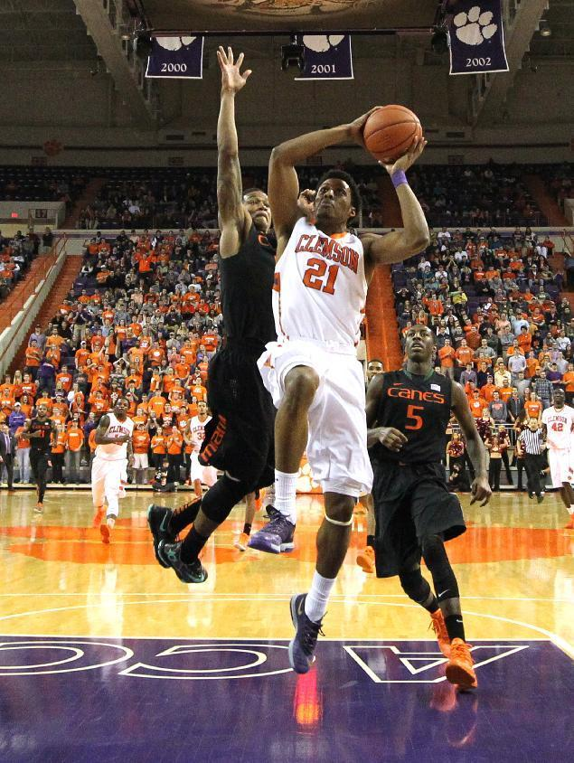 Clemson's Damarcus Harrison is fouled by Miami's Rion Brown, left, during the first half of an NCAA college basketball game at Littlejohn Coliseum Tuesday, March 4, 2014, in Clemson, S.C.. (AP PHOTO/Ken Ruinard/ Anderson Independent Mail)