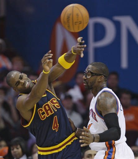 Cleveland Cavaliers' Antawn Jamison (4) passes the ball in front of New York Knicks' Amare Stoudemire (1) in the third quarter in an NBA basketball game on Wednesday, Jan. 25, 2012, in Cleveland. The Cavaliers won 91-81. (AP Photo/Tony Dejak)