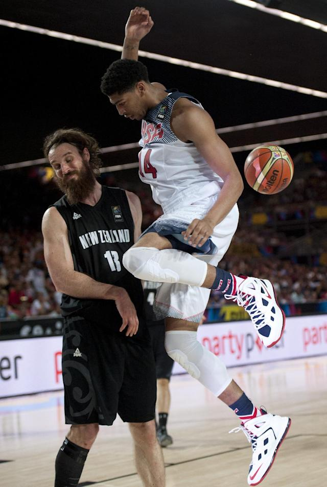 United States's Anthony Davis, dunks during the Group C Basketball World Cup match as New Zealand's Casey Frank, reacts, in Bilbao northern Spain, Tuesday, Sept. 2, 2014. The 2014 Basketball World Cup competition take place in various cities in Spain from last Aug. 30 through to Sept. 14. United States won 98-71. (AP Photo/Alvaro Barrientos)