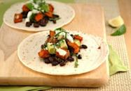 "<p><b>Get the recipe:</b> <a href=""http://whippedbaking.com/2012/10/04/in-season-vegan-sweet-potato-tacos-with-basil-lime-cream-sauce/"" class=""link rapid-noclick-resp"" rel=""nofollow noopener"" target=""_blank"" data-ylk=""slk:vegan sweet potato tacos"">vegan sweet potato tacos</a></p>"