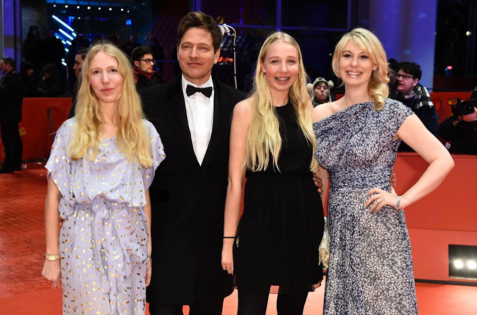 Danish director Thomas Vinterberg with daughters Nana (L) and Ida (2ndR) and actress Helene Reingaard Neumann (R) poses on the red carpet ahead of the screeing of the film