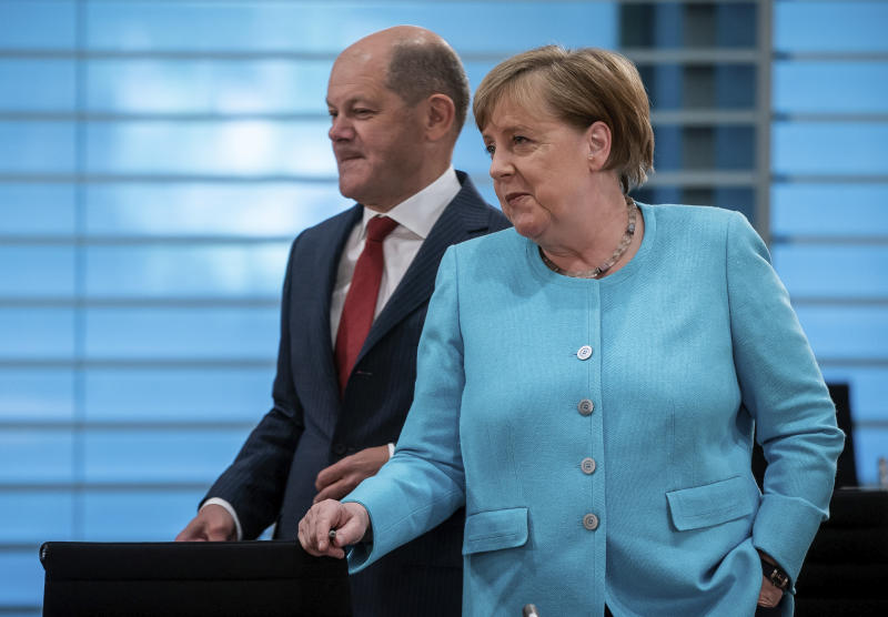 German Chancellor Angela Merkel, right, and German Finance Minister Olaf Scholz, left, attend the weekly cabinet meeting at the Chancellery in Berlin, Germany, Wednesday, June 3, 2020. (Michael Kappeler/DPA via AP, Pool)