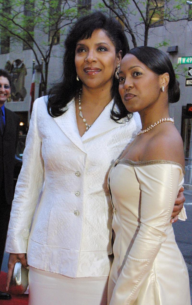 "FILE - In this May 2, 2002, file photo, Phylicia Rashad, left, and Keshia Knight Pulliam from the ""Cosby Show"" arrive at NBC's 75th anniversary celebration at New York's Rockefeller Center. The Tony Award-winning actress, Rashad, is directing a reading of the play ""Four Little Girls: Birmingham 1963"" at the Kennedy Center Sunday to mark the 50th anniversary of the bombing at 16th Street Baptist Church in Birmingham, Ala. (AP Photo/Tina Fineberg, File)"