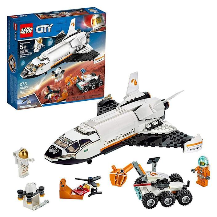 """<p><strong>LEGO</strong></p><p>amazon.com</p><p><strong>$31.99</strong></p><p><a href=""""https://www.amazon.com/dp/B07PS65RKM?tag=syn-yahoo-20&ascsubtag=%5Bartid%7C2089.g.37696840%5Bsrc%7Cyahoo-us"""" rel=""""nofollow noopener"""" target=""""_blank"""" data-ylk=""""slk:Shop Now"""" class=""""link rapid-noclick-resp"""">Shop Now</a></p><p>Your kiddo will have everything he needs for the first manned mission to Mars with this awesome kit. He can build a space shuttle piloted by two intrepid astronauts. Once he reaches his destination, he can put together a rover to collect samples to bring back to Earth.</p>"""