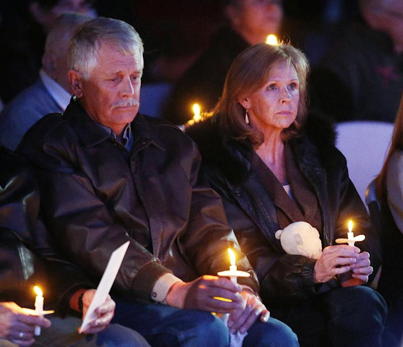 Carl and Marsha Mueller hold candles at a memorial in honor of their daughter Kayla Mueller, on Feb. 18, 2015, in Prescott, Ariz. (Photo: Rob Schumacher/The Arizona Republic)