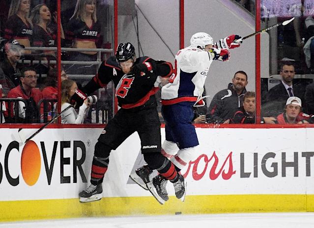 Carolina forward Jordan Staal (left) checks Washington Capitals defenceman Dmitry Orlov along the boards in the second period of a 5-2 game six victory by the Hurricanes (AFP Photo/GRANT HALVERSON)