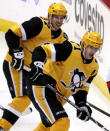 FILE - This March 12, 2019, file photo shows Pittsburgh Penguins' Evgeni Malkin (71) and Sidney Crosby (87) skating in the third period of the team's NHL hockey game against the Washington Capitals in Pittsburgh. The faces around Sidney Crosby and Evgeni Malkin change. The expectations around the Pittsburgh Penguins and their two longtime stars do not. After an offseason of retooling the coaching staff and tweaking the roster, the Penguins are hoping to rebound following a second straight early playoff exit. (AP Photo/Gene J. Puskar/File)